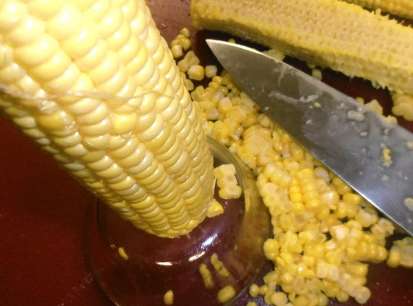 slice corn off the cobb.  scrape milk from cobb...if you have a lil'...
