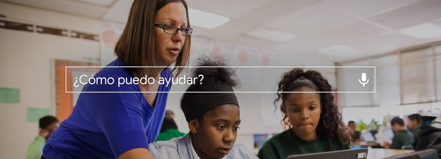 How can I give back? search box on top of an image of a teacher and students.