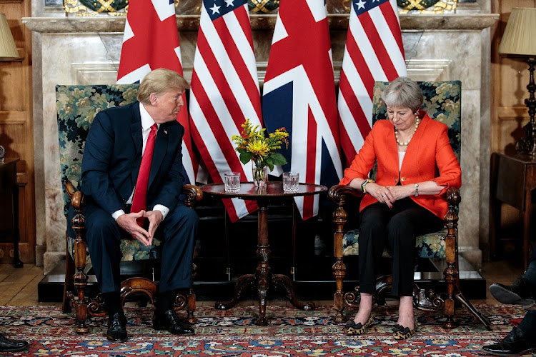 Britain's Prime Minister Theresa May poses with US President Donald Trump at Chequers near Aylesbury, Britain on July 13 2018. Picture: JACK TAYLOR/via REUTERS