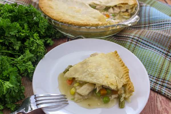 A Slice Of Simple Turkey Pot Pie On A Plate.