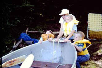 Photo: Kathy and kids working together to pull the boat up on shore.