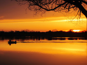 Photo: Boat in a fiery lake at sunset in Eastwood Park, Dayton, Ohio.