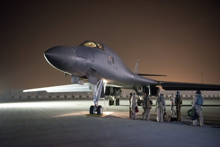 A US Air Force B-1B Lancer and crew, being deployed to launch strike as part of the multinational response to Syria's use of chemical weapons, is seen in this image released from Al Udeid Air Base, Doha, Qatar on April 14, 2018.