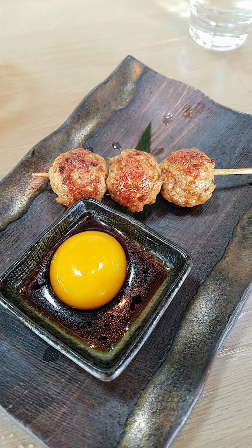 Afuri PDX Tsukune with minced chicken thigh, ginger, onion, yam, potato, egg yolk, Oregon piot noir yakitori