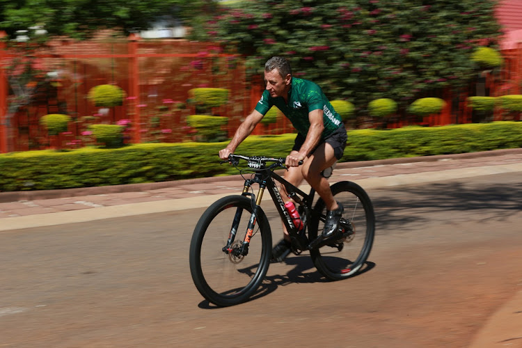 With modified training shoes and determination, a recuperating Nick Bester is back on his bike.
