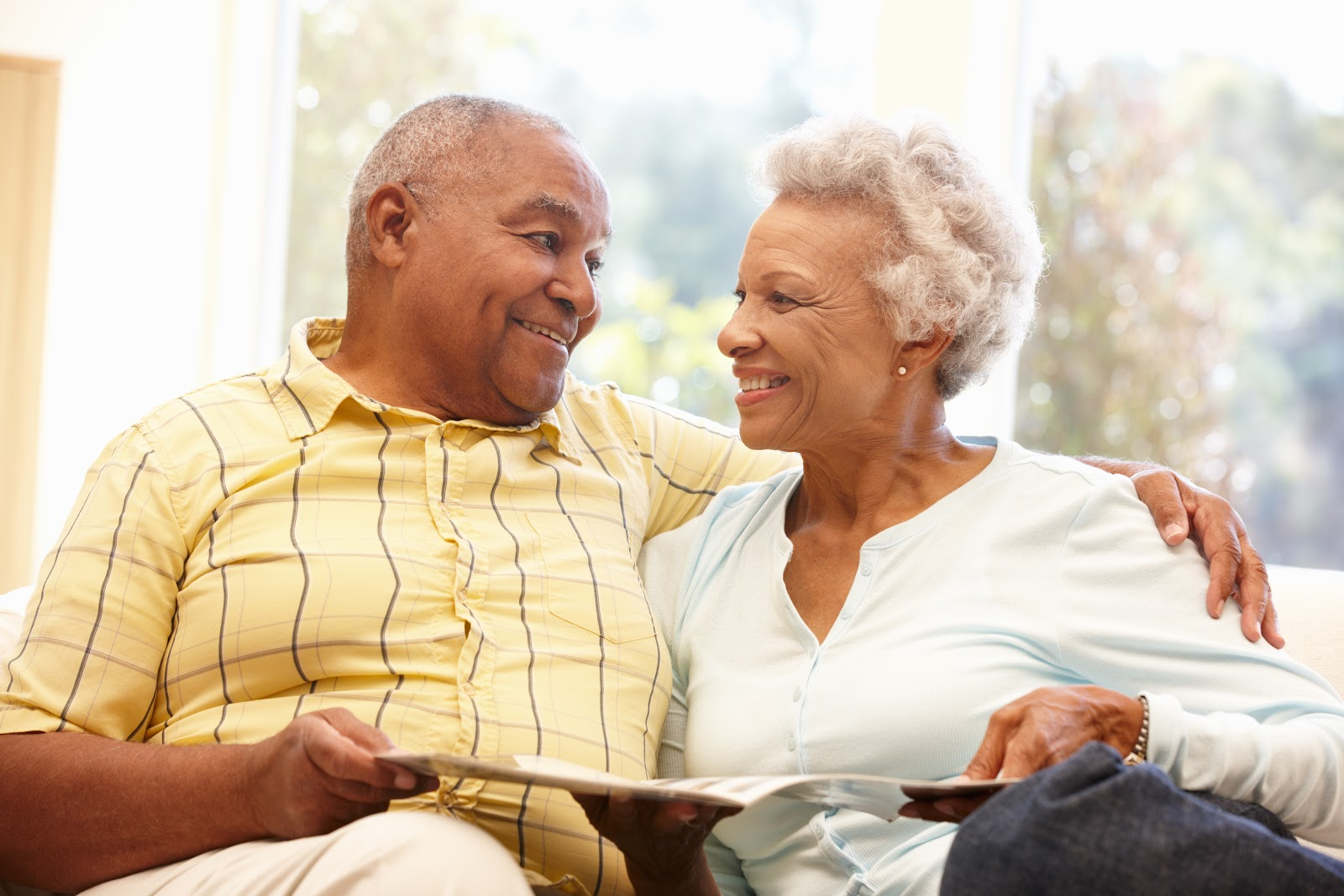 Senior couple smiling and looking at each other