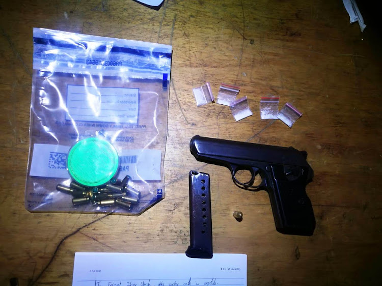 A pistol, ammunition and drugs seized in raids by the anti-gang unit on the Cape Flats
