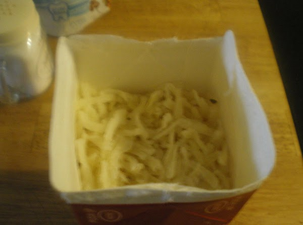 Rehydrate hash browns according to package instructions.