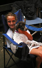 Photo: Child relaxing with her pet at Wilgus State Park