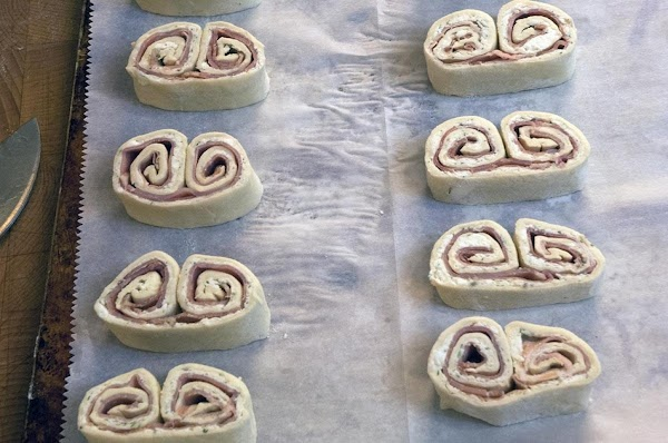 Place the sliced palmiers on a parchment-lined baking sheet and spread about 1-inch apart...