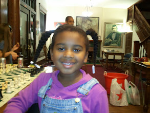 Photo: Kaleya smiles. that young lady behind her is a chess champion for her age group