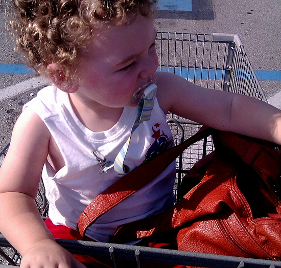 Photo: Heading into Walmart! The only challenge about bringing my toddler when I'm grocery shopping is that he takes up a lot of room in the cart! I like to put produce and bread in the seat of the cart. Not on this trip!