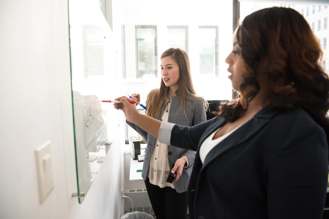 sales women writing on a whiteboard