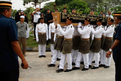 Malaysia Army personnel carry the coffin of Dora Sheila Kassim, one of the victim of MH17 in the Bukit Kiara cemetery. Picture Credit: Getty Images