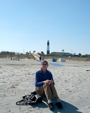 Photo: Elinor at beach on Tybee Island. That is the Tybee Island Light Station in the background.  A lighthouse was first ordered built in the 1730s by James Oglethorpe, founder of Georgia, but it and several subsequent lighthouses were destroyed over the years and had to be rebuilt, relocated, or  rehabbed.