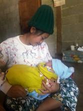 Photo: Mae Ho baby Wanida (4 months) with mum