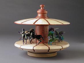 Photo: Mythic Pony Carousel James Genack, turner Patti Leota Genack, beadmaker Not shown: American Indian Ledger Book Ponies