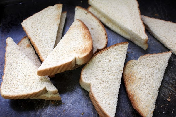 To assemble, toast 8 slices of bread; cut 4 in half diagonally.