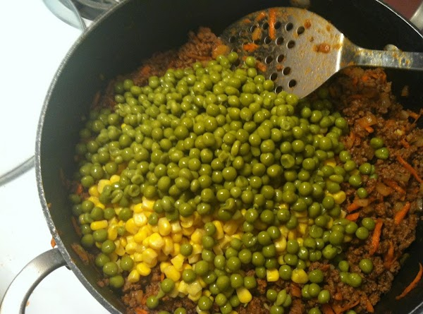 add corn and peas and combine turn heat to low and allow to simmer