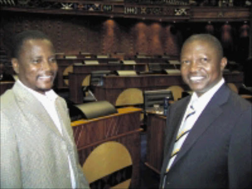 MAN AT THE TOP: Mpumalanga Premier David Mabuza, right, with former MEC for safety and security Luckson Mathebula after the swearing in ceremony. 06/05/09. Pic. Riot Hlatshwayo. © Sowetan.