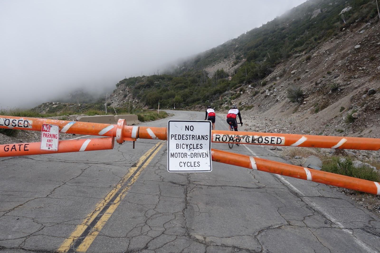Dawson Saddle bicycle climb - gate and sign prohibiting vehicle and bike traffic.