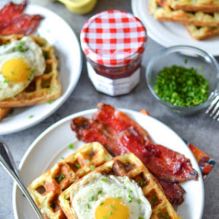 Cheddar Chive Waffles & Eggs with Strawberry Candied Bacon.