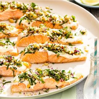 Salmon With Macadamia Herb Crumb And Tahini Sauce.