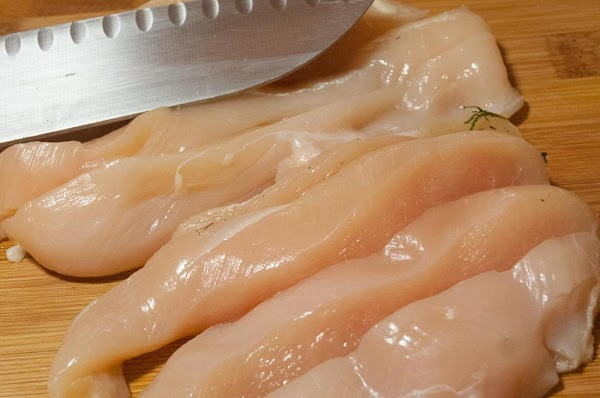 Cut the chicken breasts into strips, about 1 inch wide.
