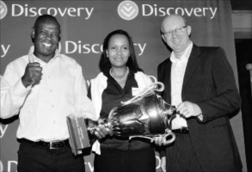 THUMBS UP: Safa Soweto chairperson Phil Mogodi, left, Discovery deputy general manager of marketing services Immaculata Matjila and Vitality Wellness head Craig Nossel at the Discovery Walter Sisulu Soccer Challenge draw yesterday in Kliptown, Soweto. Pic: VELI NHLAPO. 24/11/2009. ©