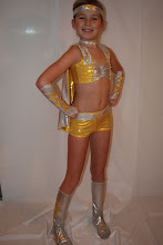 Photo: Notice: Buyers from Illinois restricted. Sorry!   Custom made.  To buy (CSD011e - Cartoon Hero) email me at Pam@act2dancecostumes.com  $75.00/obo  QTY (1) sz: Child small to Child Medium.  Measurements of dancer in photo are B-24, W-23, H-25.5, G- 45.5.  If you need a cute costume then I have it right here.  Cartoon Heros says it all.  Design:  Half top with cape w/lighting bolt.  Bootie shorts, choker, headband and boot cover w/lighting bolt.  5 gross swarovski AB rhinestones!  7 day return, minus shipping.  $6 US shipping, $2 additional items.  Can set up payment via paypal or I will take checks.  Thank you for looking at my listing.  I welcome questions.  CS011e