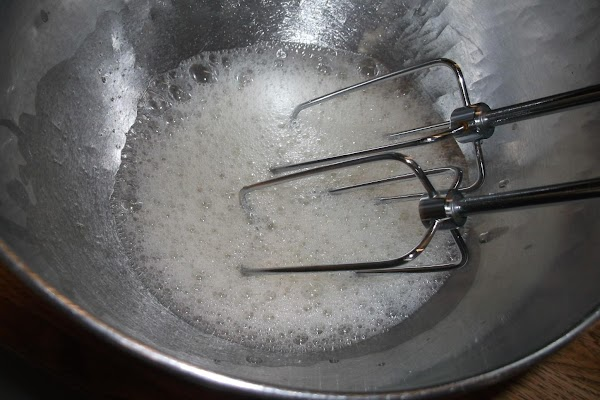 In mixing bowl, beat egg whites until frothy (a few seconds.)