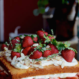 Naked Strawberry Almond Cake with Honey Rose Cream Cheese Frosting.