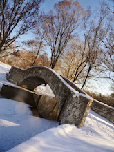 Photo: Stone bridge over a snowy winter lake at Eastwood Park in Dayton, Ohio.