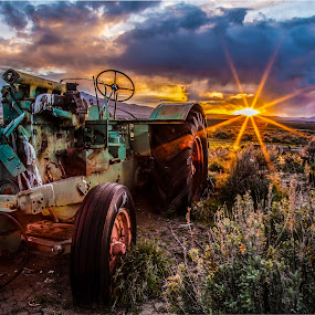Best Days Behind by Mike Lee - Landscapes Sunsets & Sunrises ( tractors, desert, ruin, antique tractors, rustic, forgotten, sun rays, classic tractors, farm, sun burst, sunset, rust, tractor, decay, abandoned,  )
