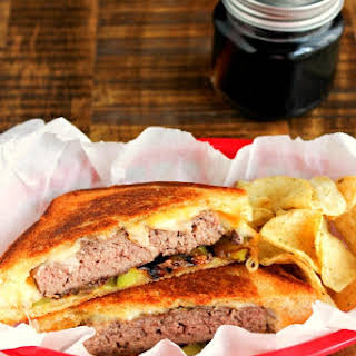 Grilled Cheese Angus Burgers with Caramelized Onions.