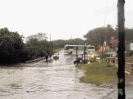 DISASTROUS: Heavy rain and floods wreaked havoc in several parts of KwaZulu-Natal, disrupting traffic, uprooting trees and killing four children. 18/06/08. © Unknown.