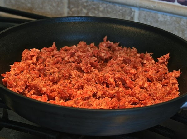 In small bowl, mix up spice mix and set aside. Slit open sausage casings...