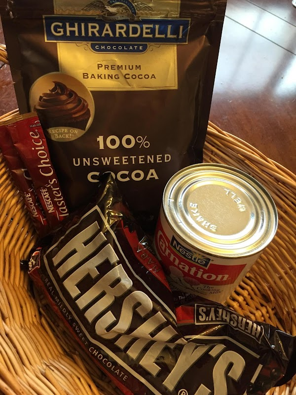 In a sauce pan, mix the coffee, cocoa, and  chocolate chips with 1...