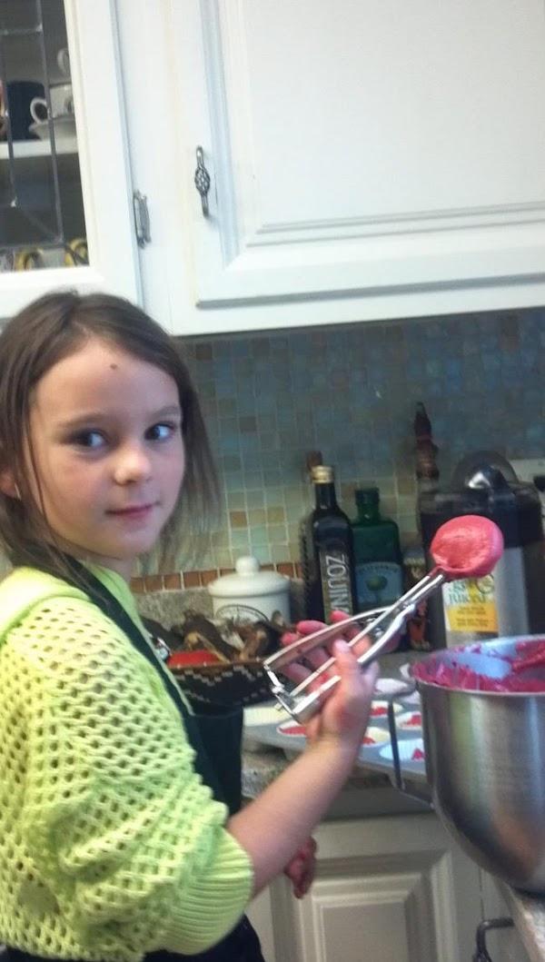 My granddaughter Maleia making cupcakes