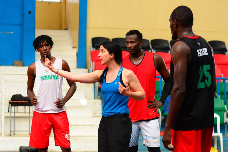 Morans' coach Liz Mills issues instructions to Faheem Juma,Desmond Owili and Fidel Okoth in a past training session at Nyayo Gymnasium.