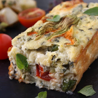 Cherry Tomato Clafoutis with Goat'S Cheese, Basil & Courgette Blossom Recipe