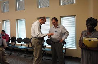 Photo: SCORE's Joe Ewart (R) engaged in individual counseling