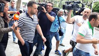 Entrada de uno de los miembros de la \'Manada\' llegando al juzgado