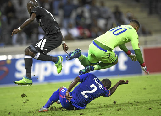 Pirates' Musa Nyatama evades double challenge from United duo of Ronwen Williams and Richard Boateng.