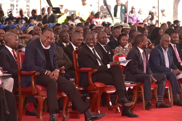 President Uhuru Kenyatta with his deputy William Ruto and other leaders and Kenyans at the funeral of musician John De Mathew, Gatanga, Murang'a County on August 24, 2019.