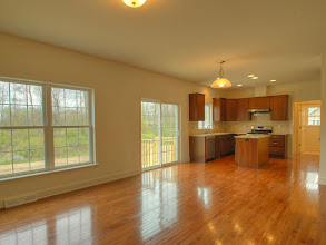 Photo: The kitchen and family room in the TYLER