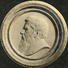 Photo: Circular white marble medallion of Wallace featuring a side profile of his head, facing left, in Westminster Abbey in the North Aisle of the Choir, between those of Charles Darwin and Joseph Lister. It was commissioned by the Wallace Memorial Committee and carved by Albert Bruce-Joy, who based it on a medallion he had previously made of Wallace from photographs and in life. It was unveiled on 1st November 1915. This photograph was taken c. 1915. Scanned with permission from an original print owned by the Wallace family. Copyright of scan: A. R. Wallace Memorial Fund & G. W. Beccaloni.