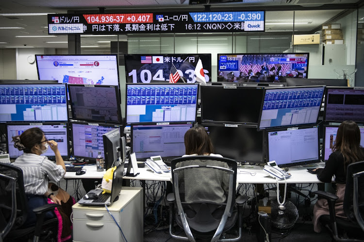Foreign exchange traders monitor screens in Tokyo, Japan. Picture: GETTY IMAGES/CARL COURT