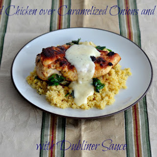 Sauteed Chicken over Caramelized Onions and Spinach with Dubliner Sauce