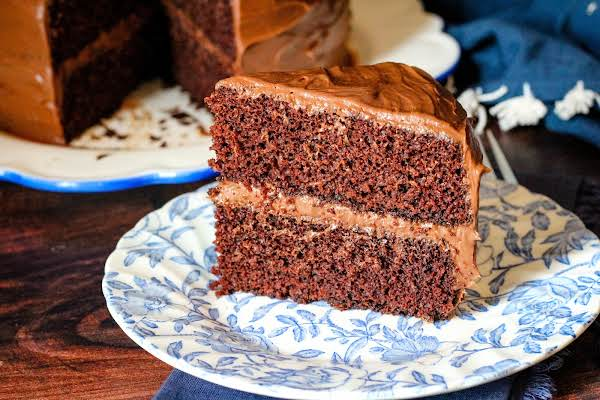 A Slice Of Great Grandma Young's Homemade Chocolate Cake On A Plate.